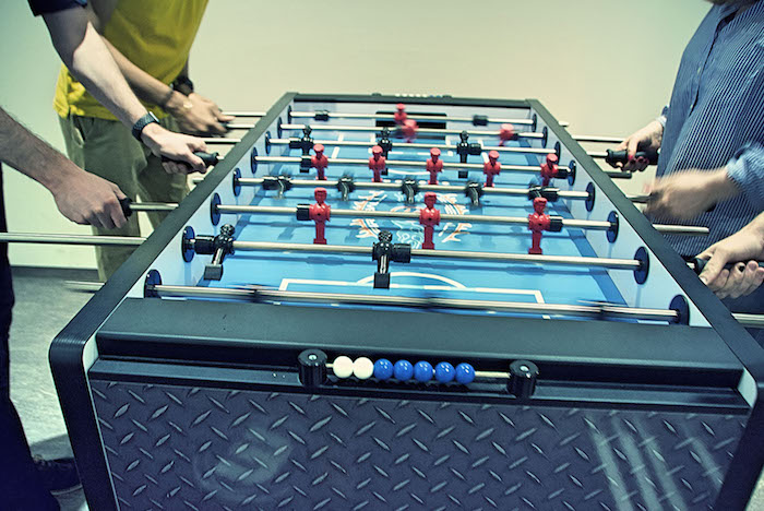 Neos IT Services, working environment, employees playing table football